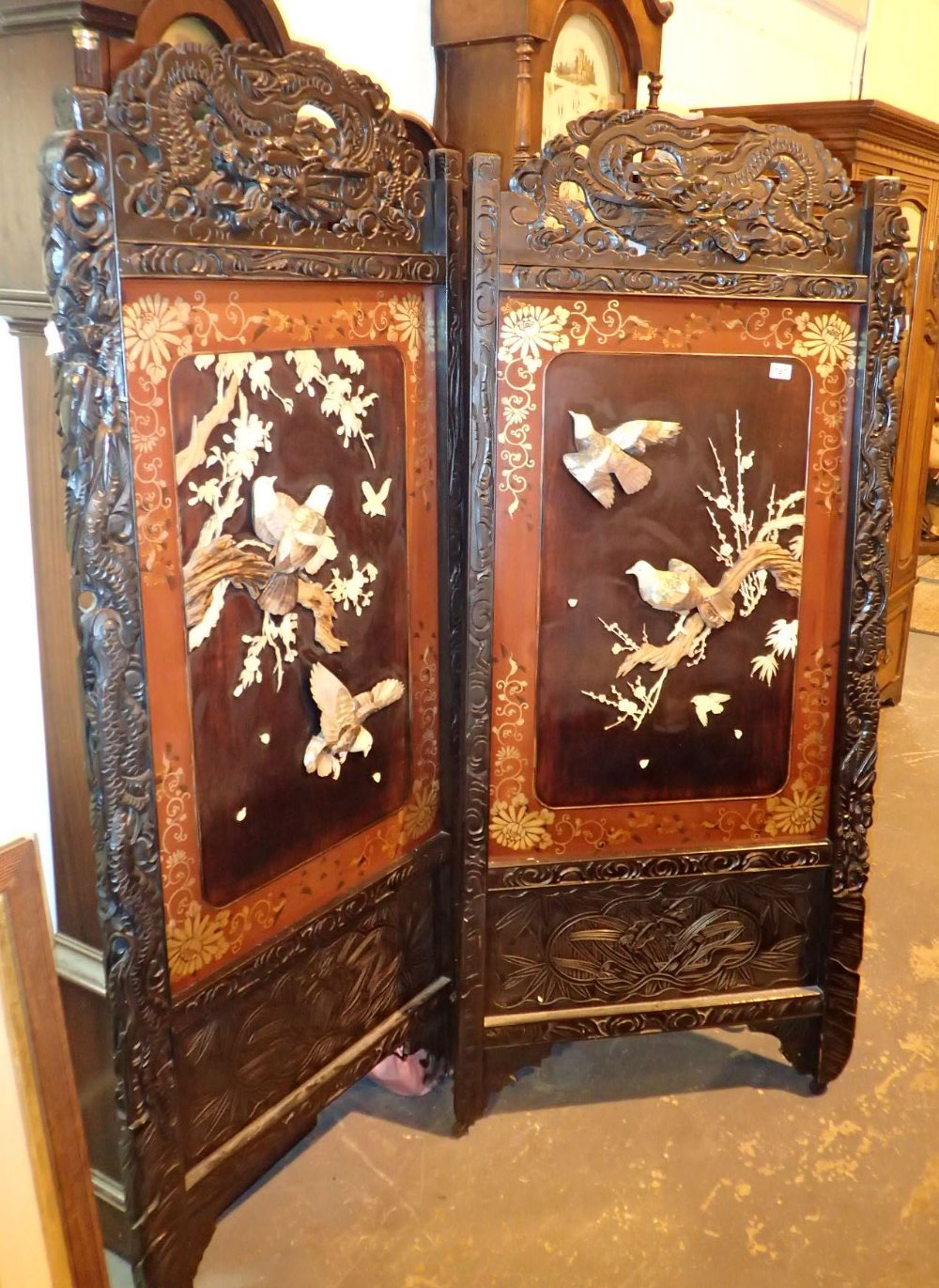 Lot 747 - Large folding heavily carved Oriental screen with mother of pearl bird decoration 179 x 79 x 2 cm