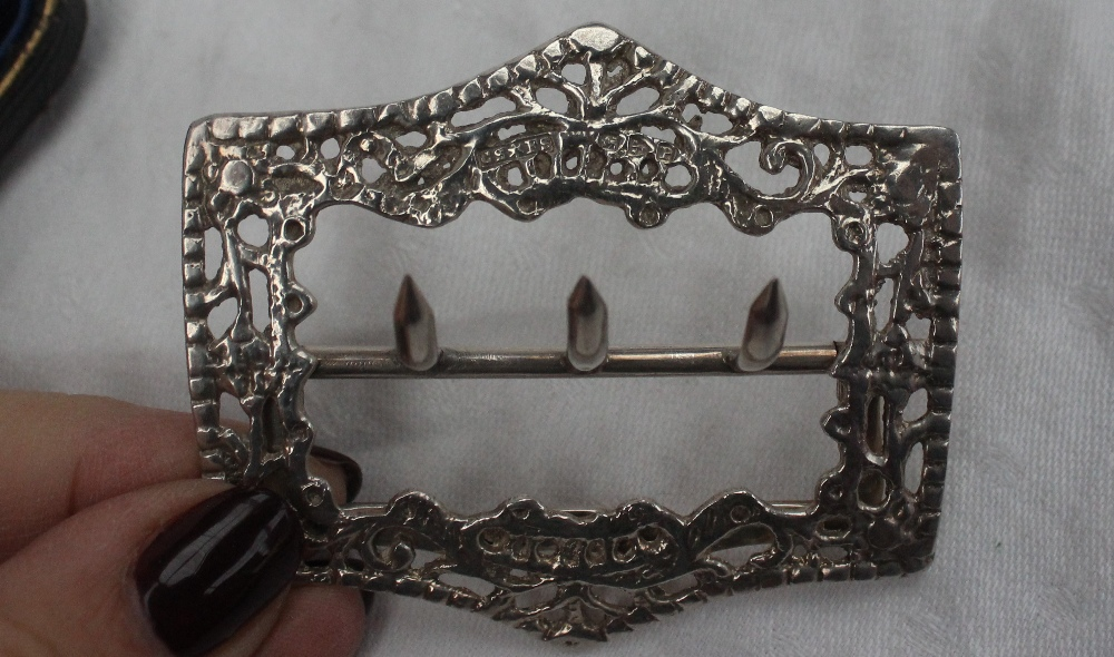 Lot 342 - A late Victorian silver buckle, Chester, 1898 together with a Pair of silver buckles,