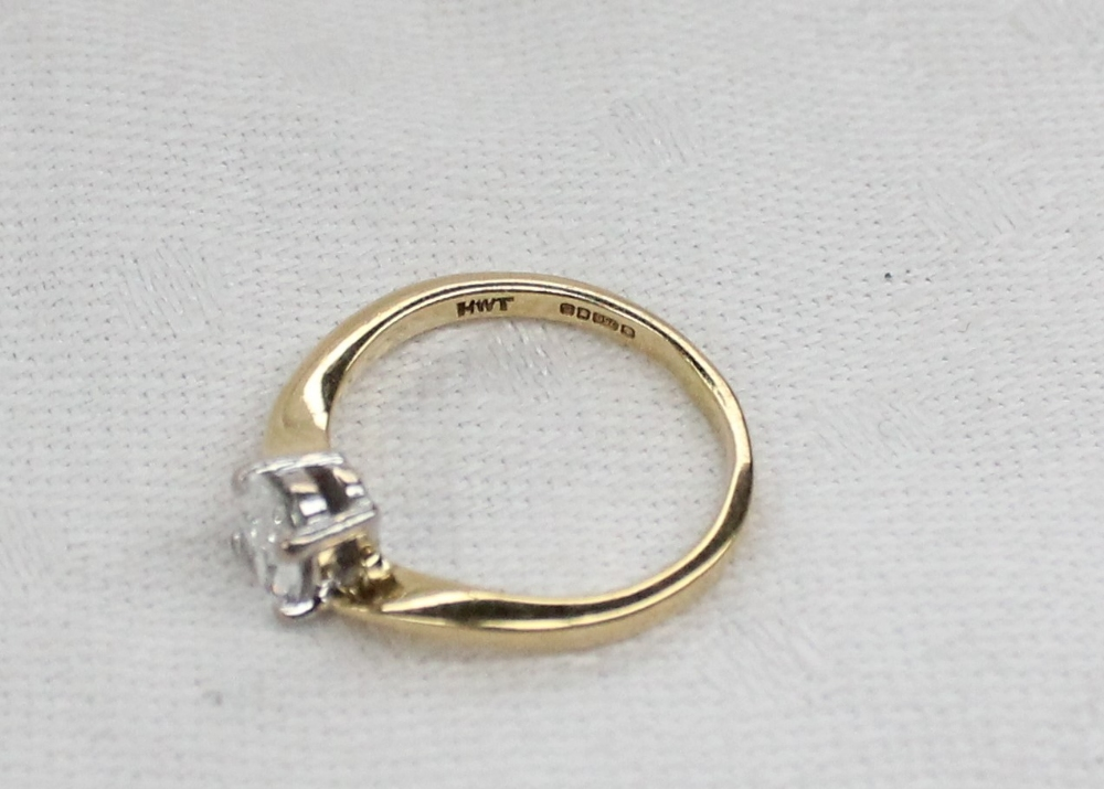 Lot 3 - A solitaire diamond ring, the oval faceted diamond approximately 0.