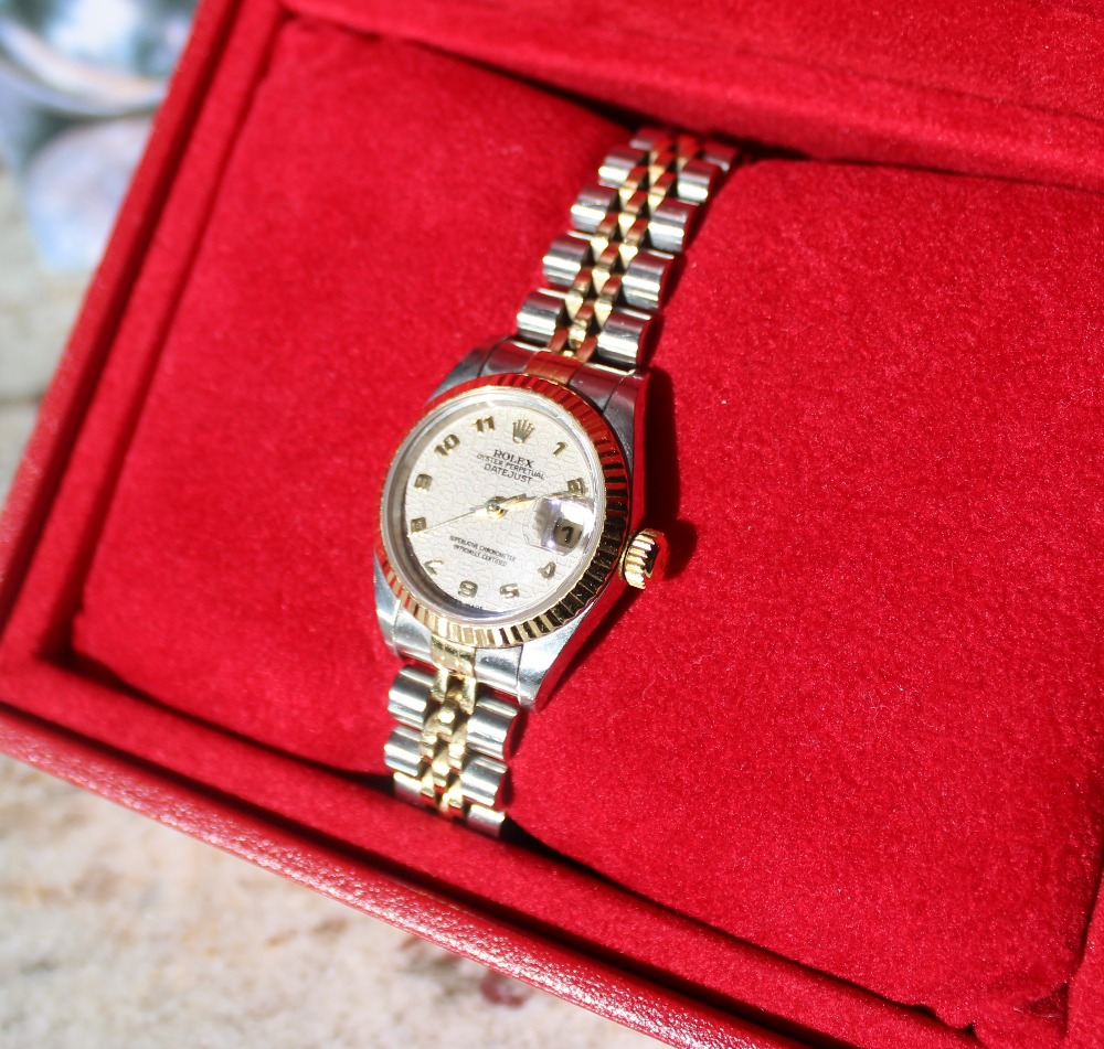 "Lot 147 - A Lady's stainless steel Rolex oyster perpetual Datejust wristwatch with a ""Rolex impressed dial"""