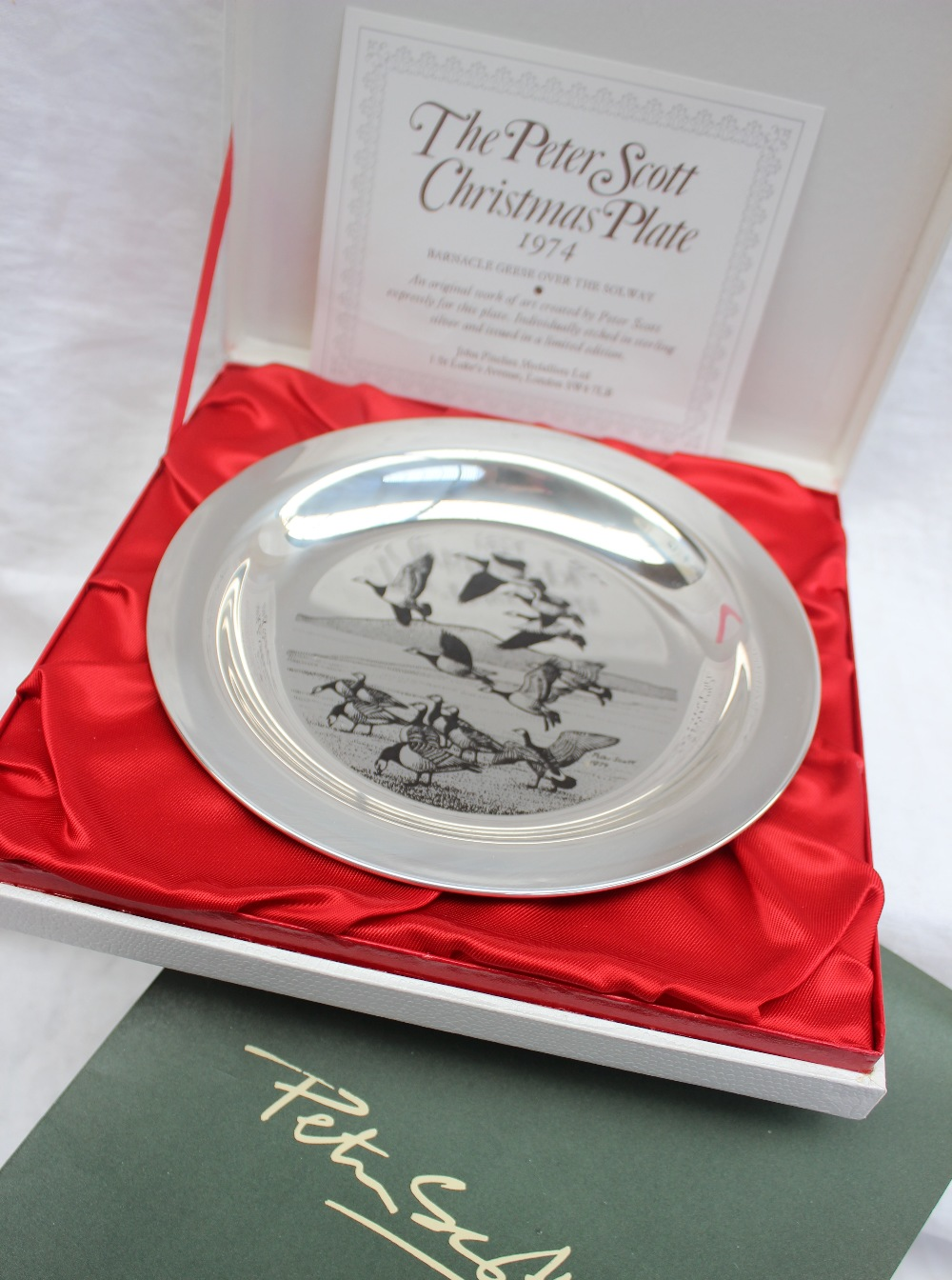 Lot 311 - An Elizabeth II silver Peter Scott Christmas Plate 1974, decorated with Barnacle geese over Solway,