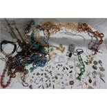 A collection of costume jewellery including necklaces, earrings, brooches,