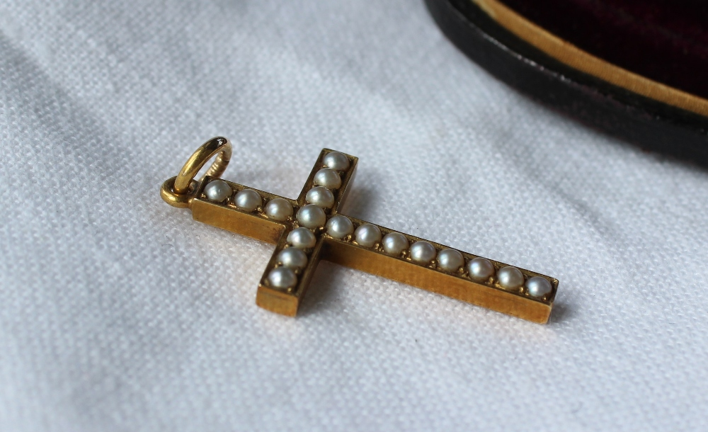 Lot 46 - A yellow metal and pearl set cross, on a suspension ring, approximately 3.