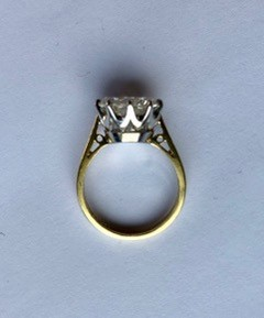 Lot 220 - A 4.25ct solitaire diamond ring, the round brilliant cut diamond measuring approximately 10.76-10.