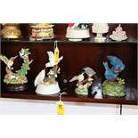 Four bird figurines