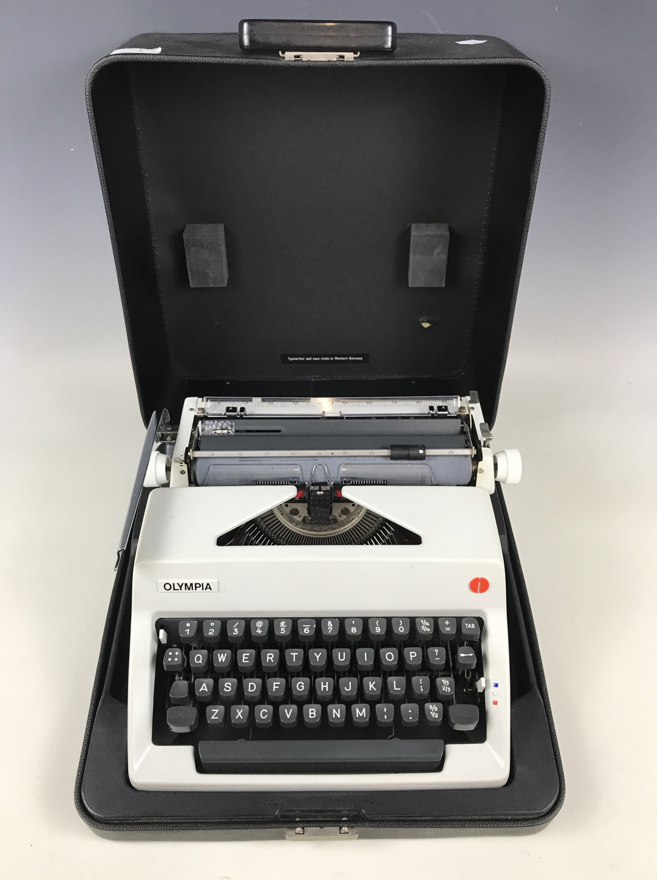 Lot 2 - An Olympia portable typewriter