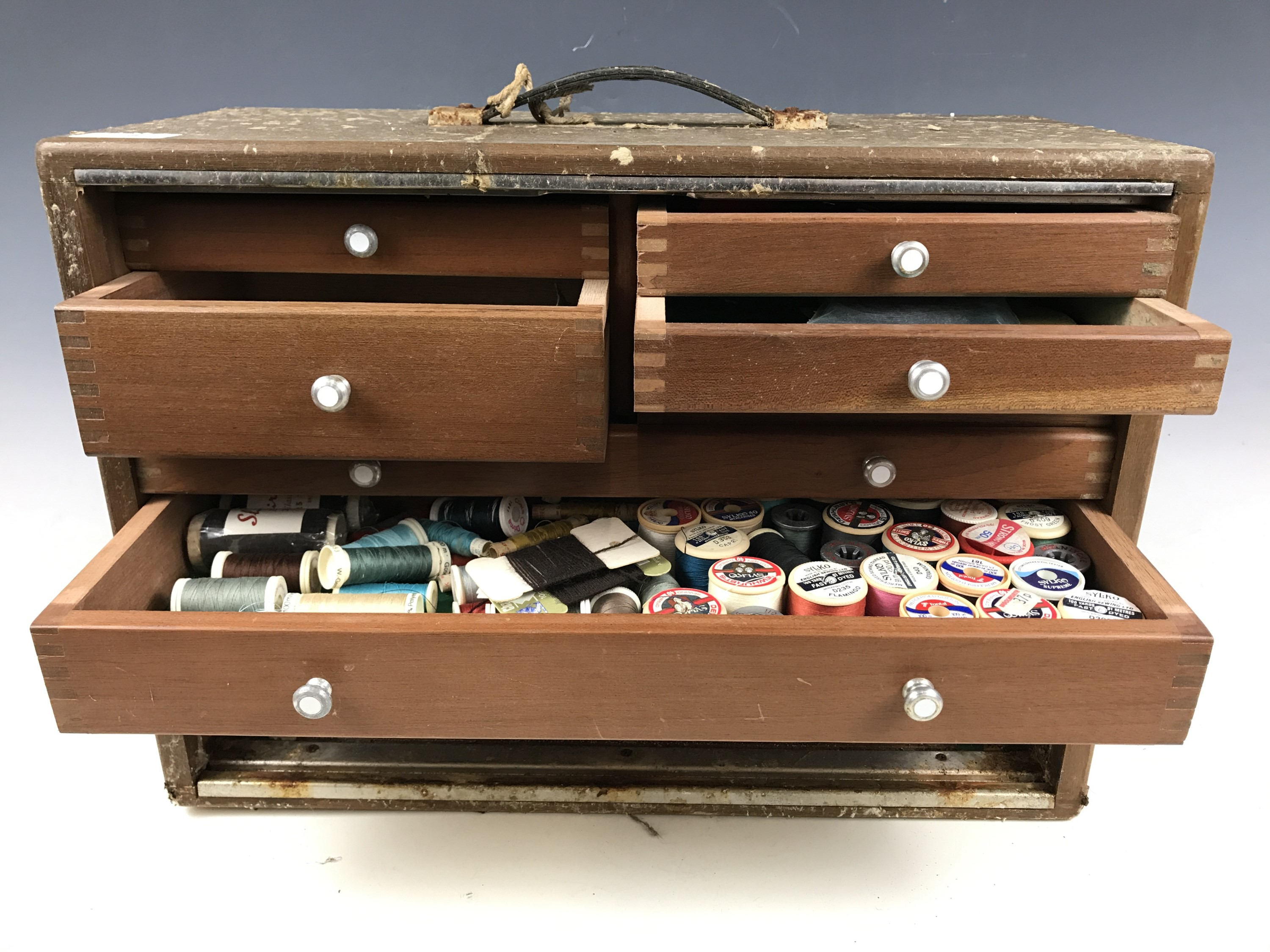 Lot 8 - A Neslein sewing cabinet together with accessories
