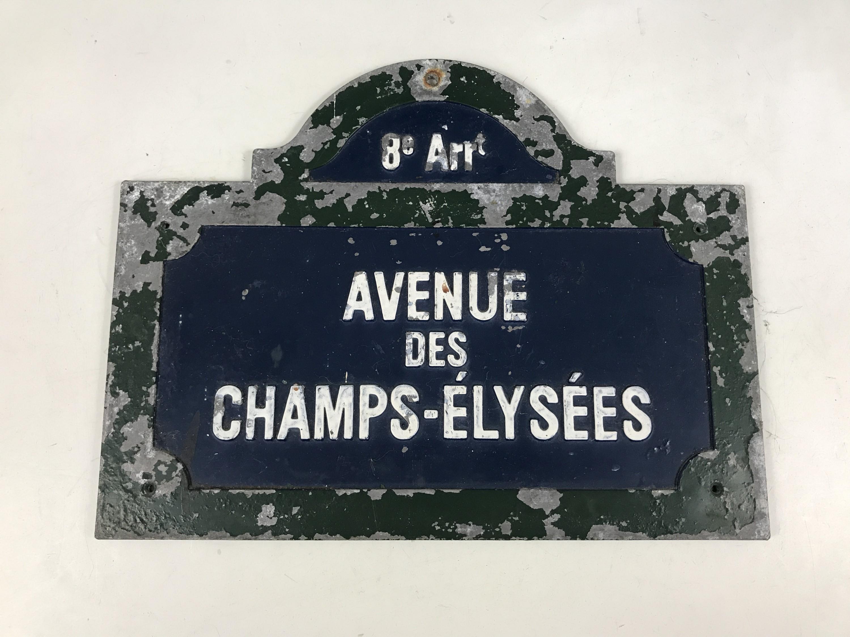 "Lot 4 - A French ""Avenue des Champs-Elysees"" enamelled cast alloy street sign, 27 x 21 cm"