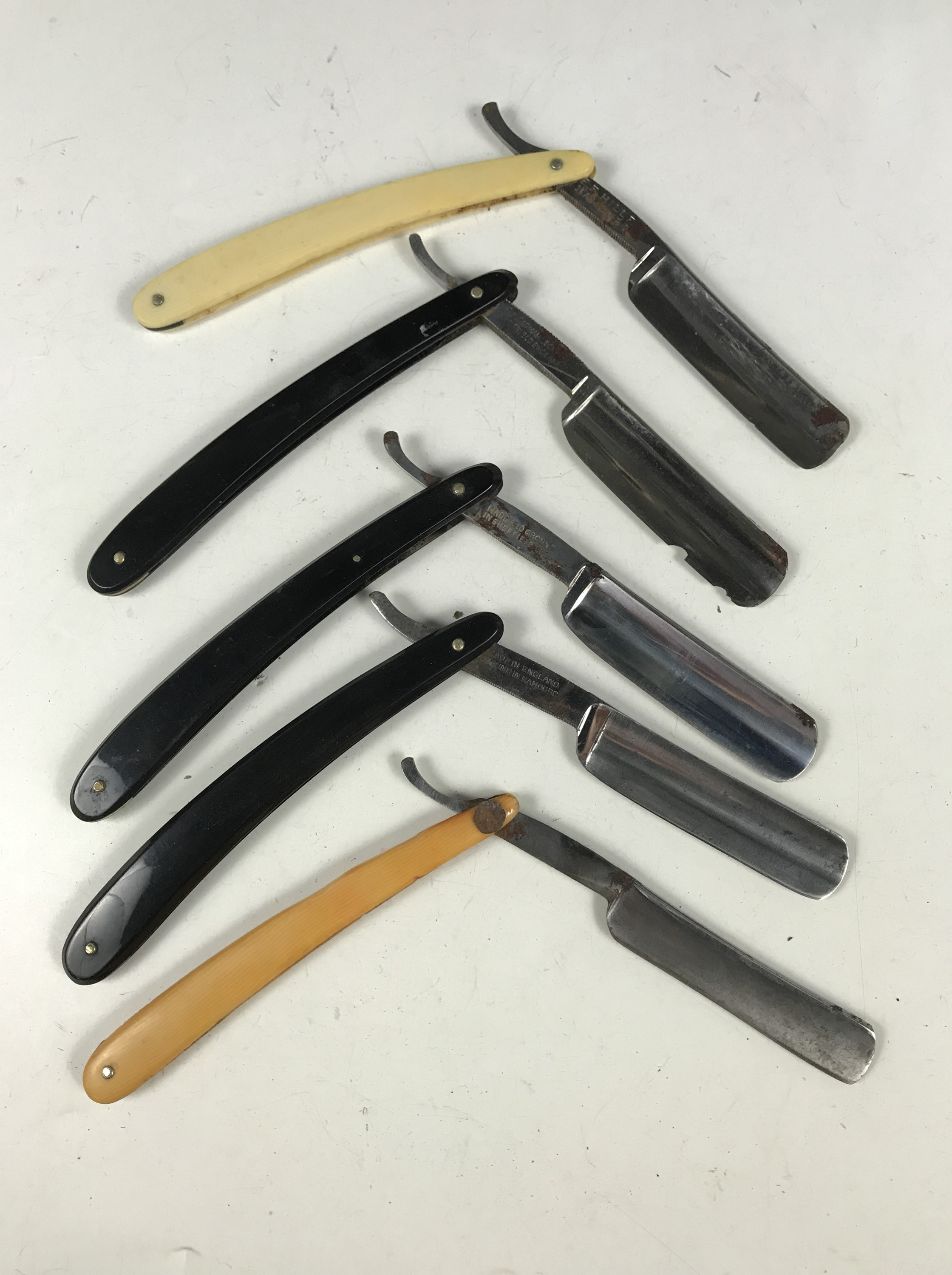 Lot 49 - Five vintage razors together with a strop