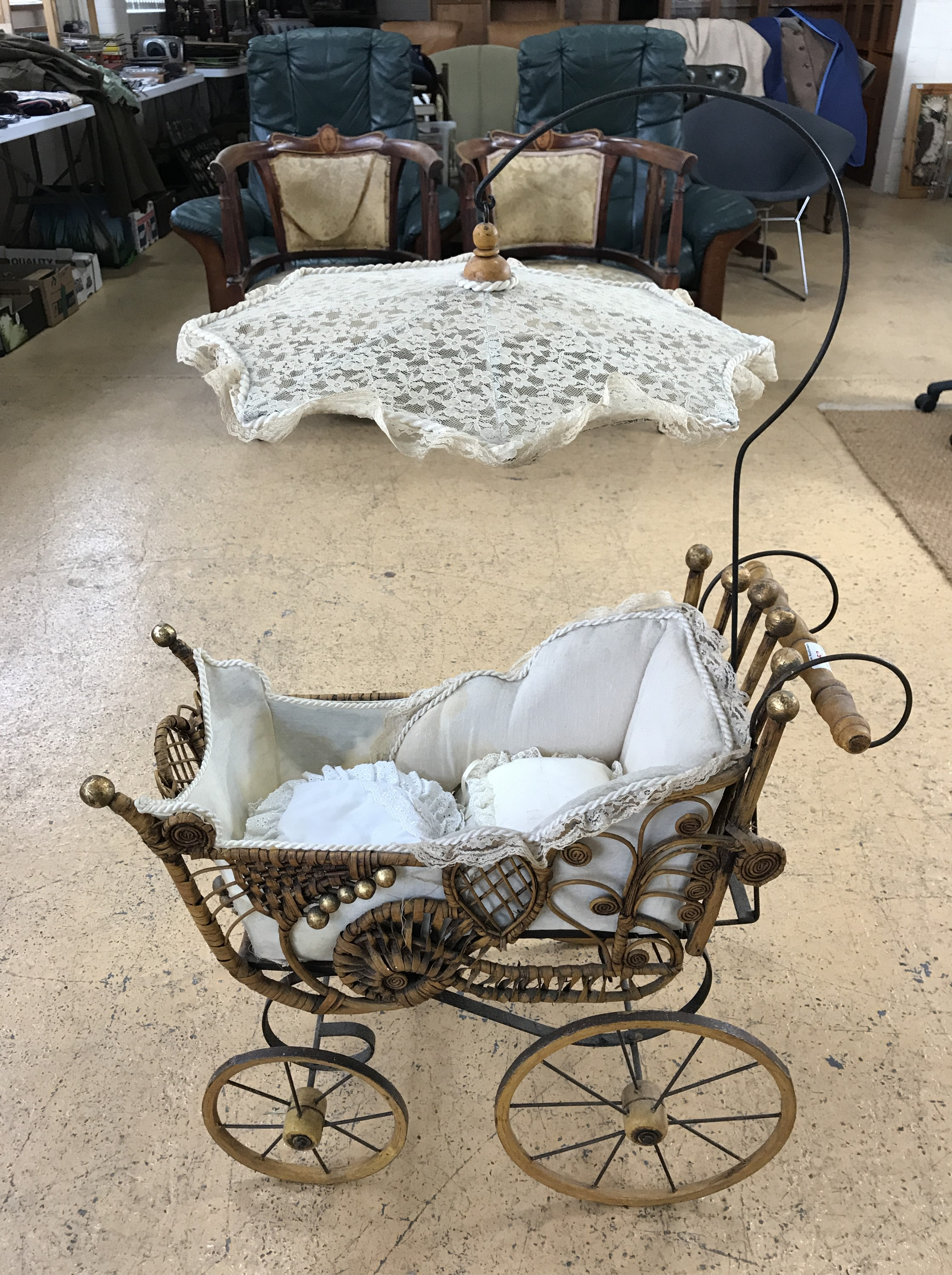 Lot 53 - A reproduction Victorian doll's pram