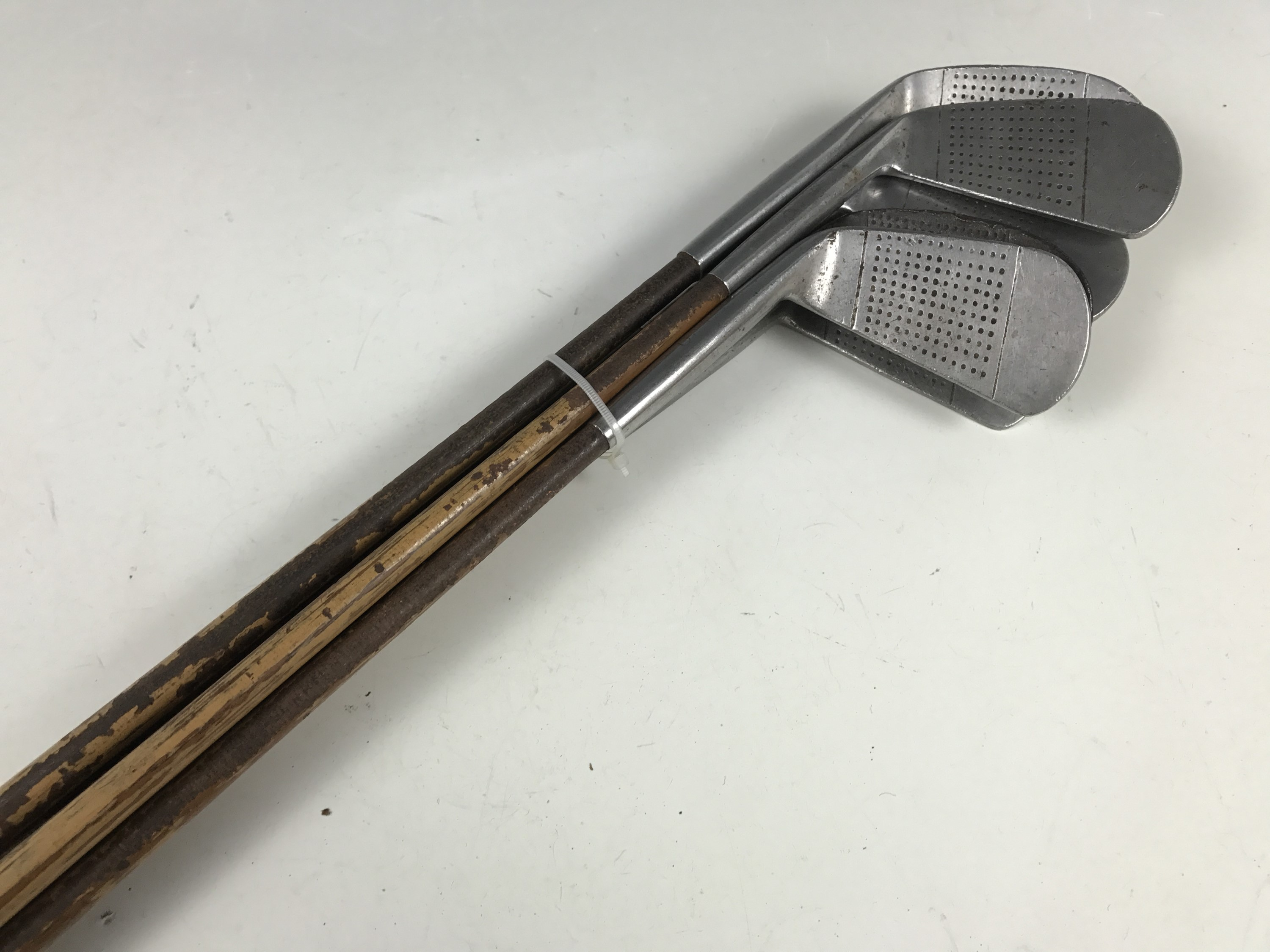 Lot 54 - A set of vintage The Fifer golf clubs and a Niblick by M Houston of Irvine