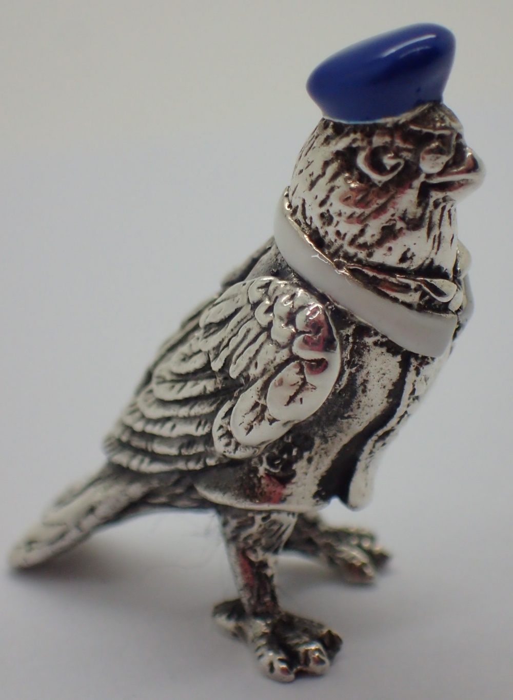 Lot 1223 - 925 silver pigeon with blue hat L: 3 cm