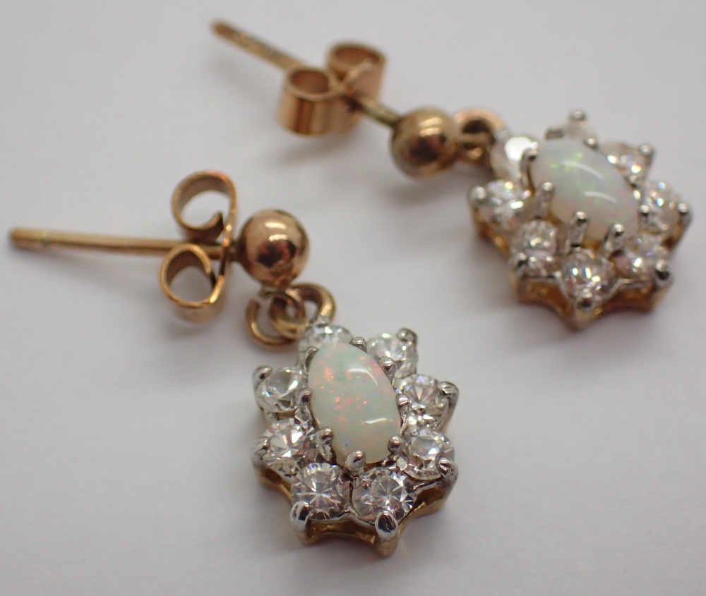 Lot 1206 - 9ct gold opal and cubic zirconia drop earrings