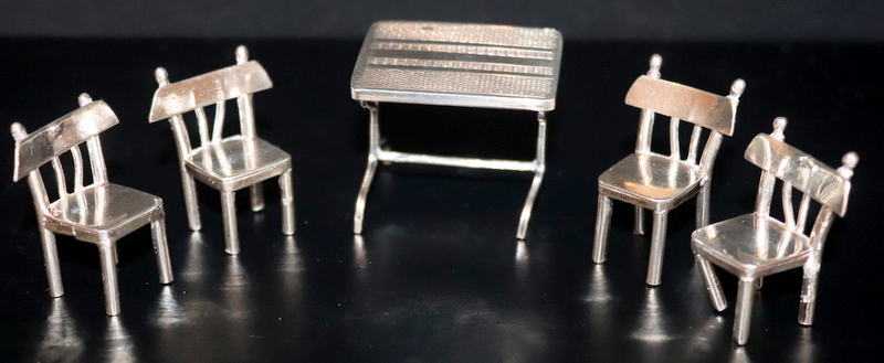 Lot 99 - Novelty Silver Miniature Dining Table And Four Chairs, All Matching With Middle