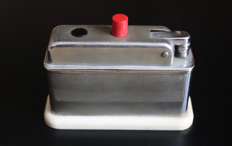 Lot 187 - Art Deco Chromed Table Lighter, Engine Turned Body With Ivory Lucite Base