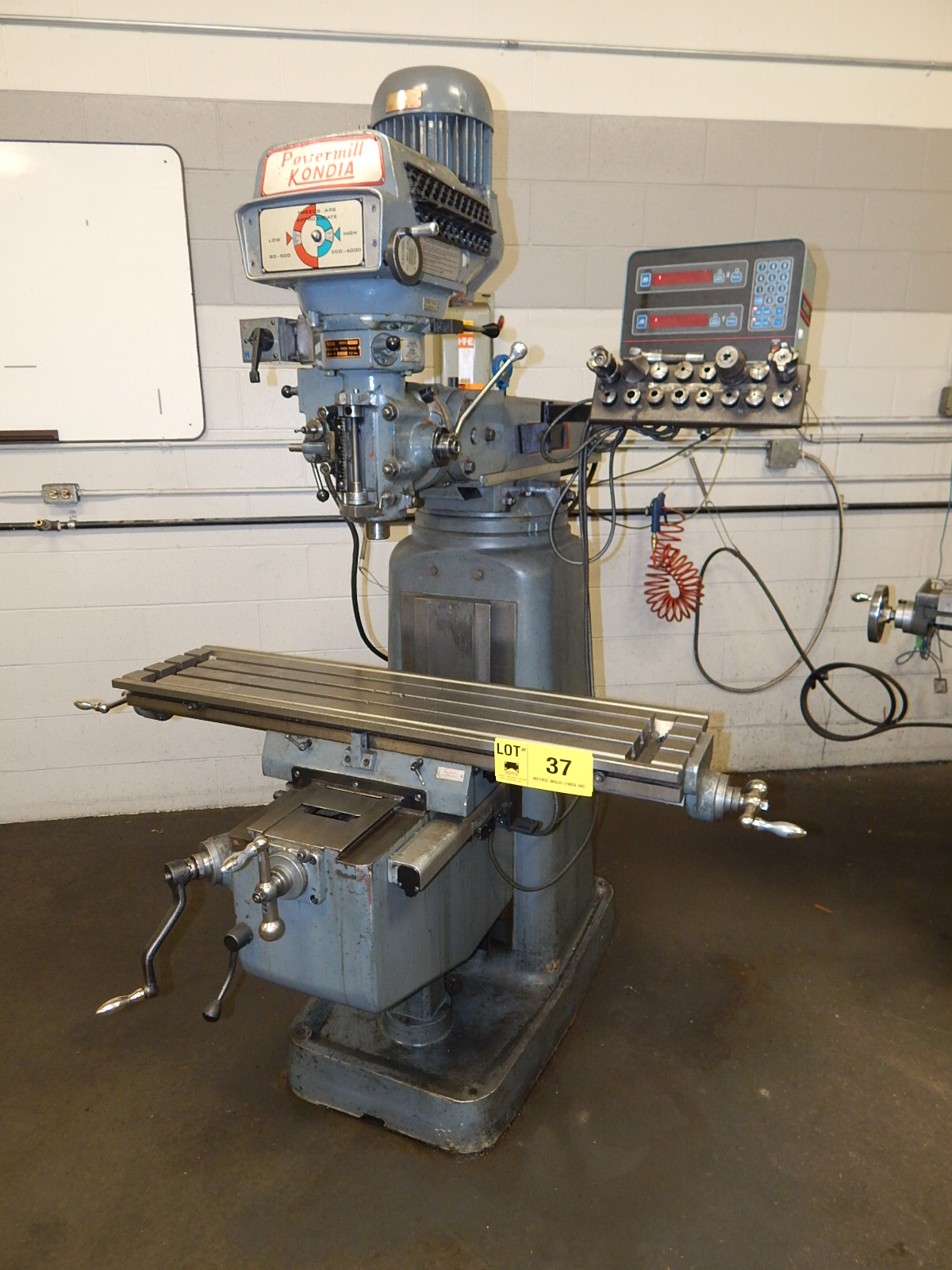 """KONDIA FV-1 VERTICAL TURRET MILL WITH 48""""X12"""" TABLE, SPEEDS TO 4000 RPM, ACCURITE III 2 AXIS DRO,"""