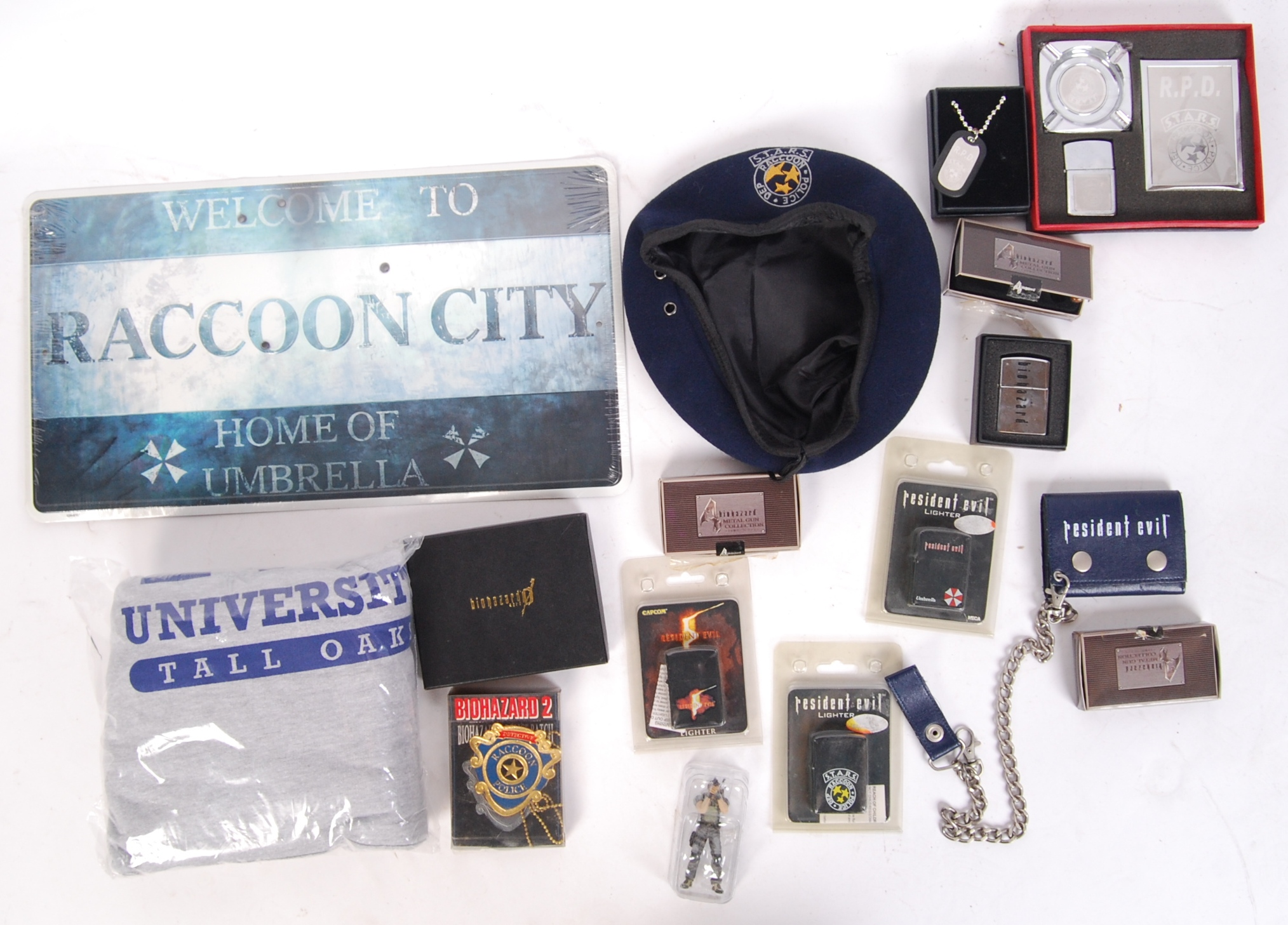 A Collection Of Various Branded Loose Resident Evil Replica Props Merchandise To Include Umbre