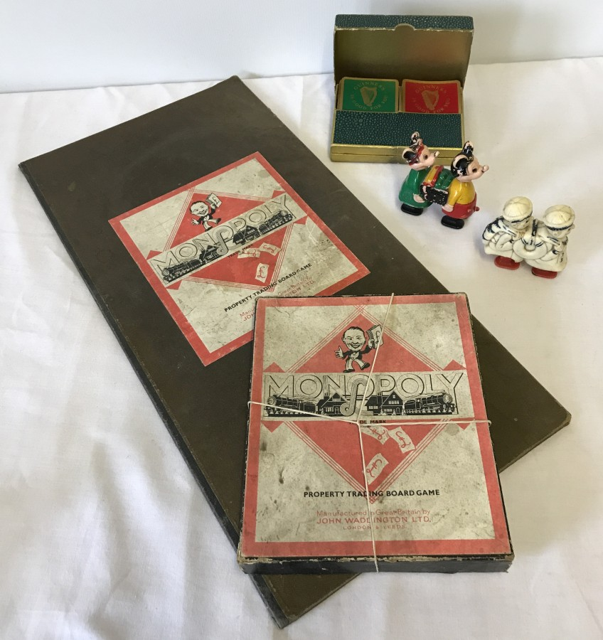 Lot 138 - A quantity of vintage toys comprising Monopoly board game, Guinness playing cards and wind up toys.