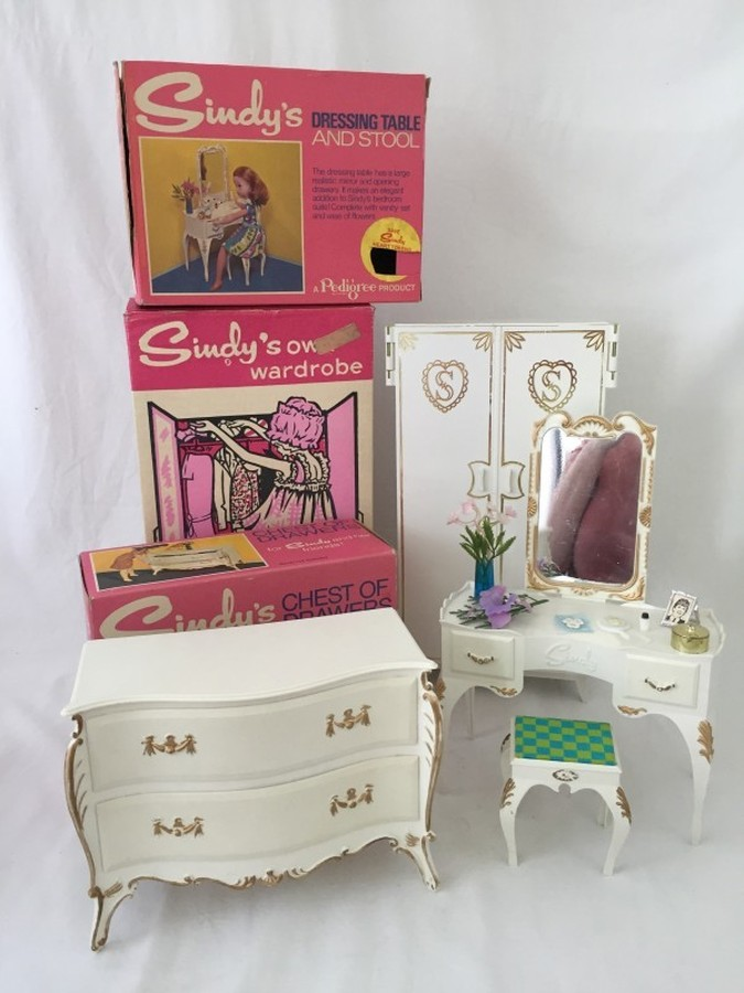 Lot 164 - A boxed Sindy chest of drawers together with a boxed wardrobe and a boxed dressing table and stool.