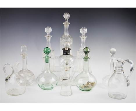 A selection of 19th century and later decanters and stoppers to include, a silver mounted glug glug decanter, 29cm high, a wh