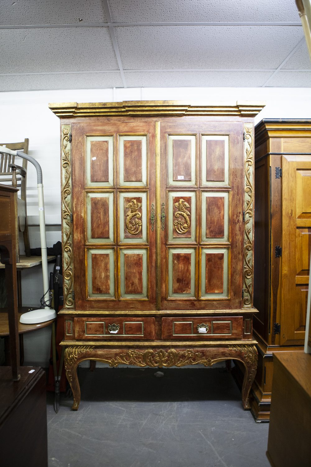 Lot 56 - A LARGE RED AND GILT DECORATED CONTINENTAL CABINET ON STAND, WITH DRAGON MOTIF TO EACH DOOR AND