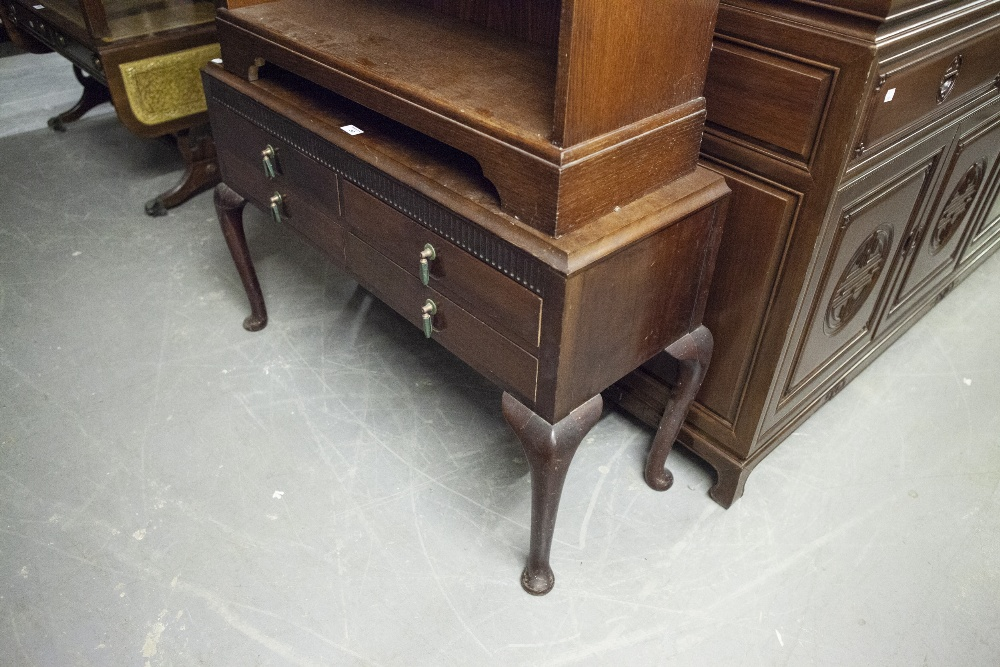 Lot 30 - CIRCA 1920's CARVED MAHOGANY LOW CHEST OF FOUR DRAWERS, RAISED ON TALL CABRIOLE LEGS