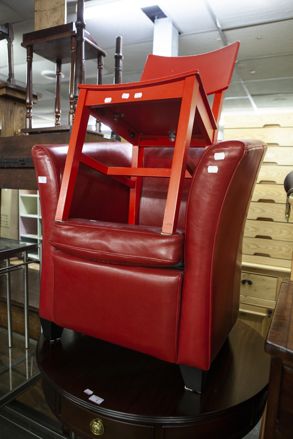 Lot 7 - LEATHER SHAPED TUB CHAIR AND A RED SINGLE WOODEN CHAIR