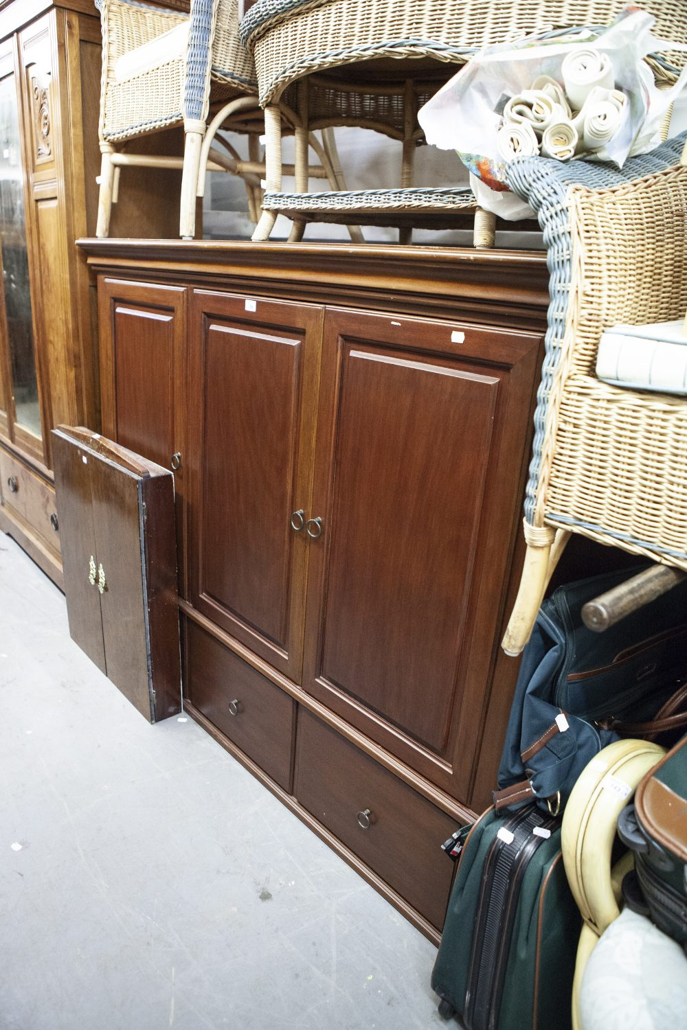 Lot 59 - A LARGE MAHOGANY THREE DOOR TELEVISION AND STEREO CABINET, RAISED ON BUN FEET