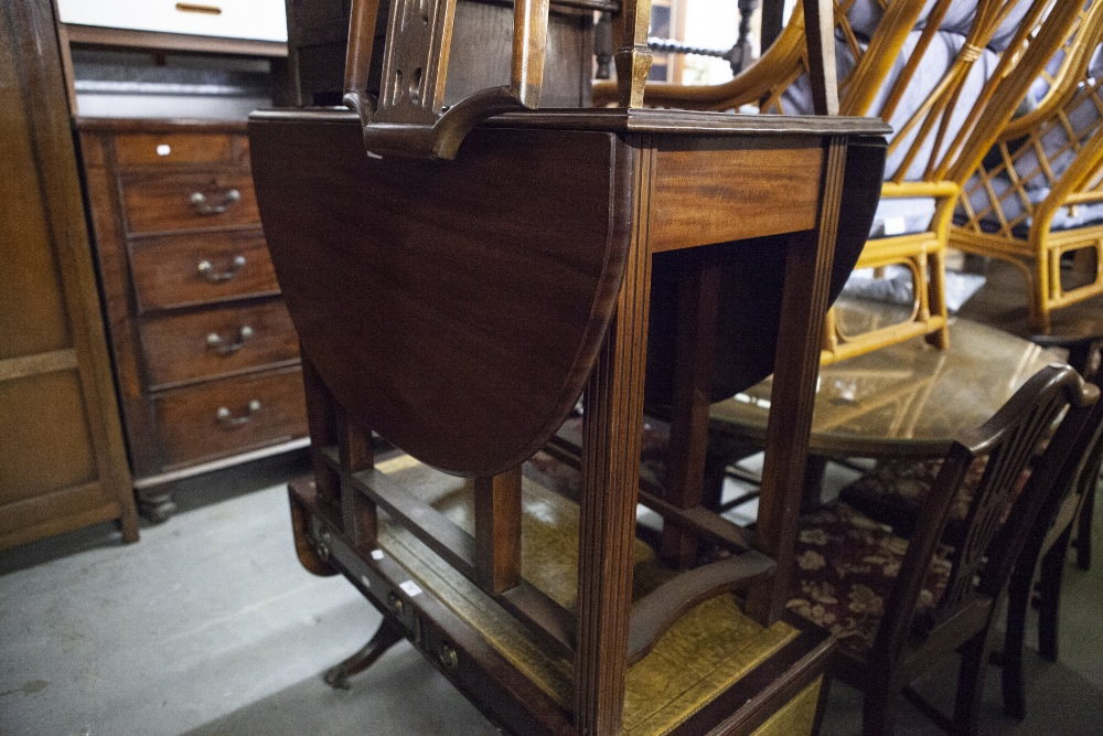Lot 16 - MAHOGANY DROP-LEAF DINING TABLE, AN OAK TEA TROLLEY; ANOTHER TEA TROLLEY