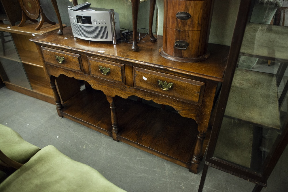 Lot 45 - SEVENTEENTH CENTURY STYLE SMALL OAK DRESSER WITH A ROW OF THREE SHORT DRAWERS WITH THREE BALUSTER