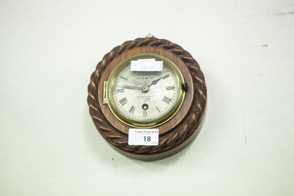 Lot 18 - A WOODEN CASED SMALL WALL CLOCK, WITH ROPE DECORATION, 8 DAY FRENCH PLATFORM ESCAPEMENT, SILVERED