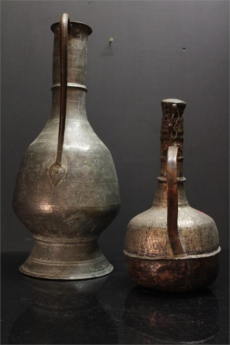 Lot 61 - A large Daghastan mid 18th century water vessel copper with zinc coating; 61cm high and a large