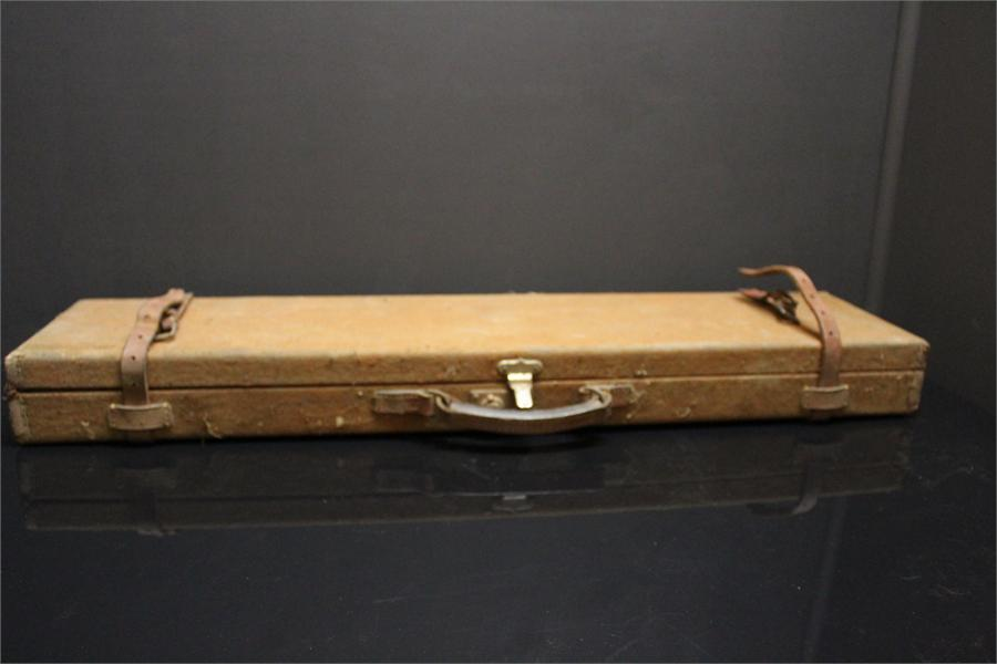 Lot 30 - A Canvas Covered Shotgun case with leather trim