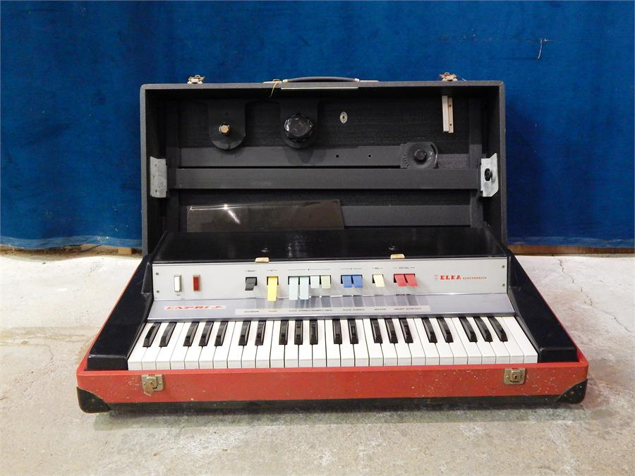 Lot 53 - 1960`s /1970`s electric organ Elka Panther 2100 or Capri Junior - - (No leads) with suitcase stand.