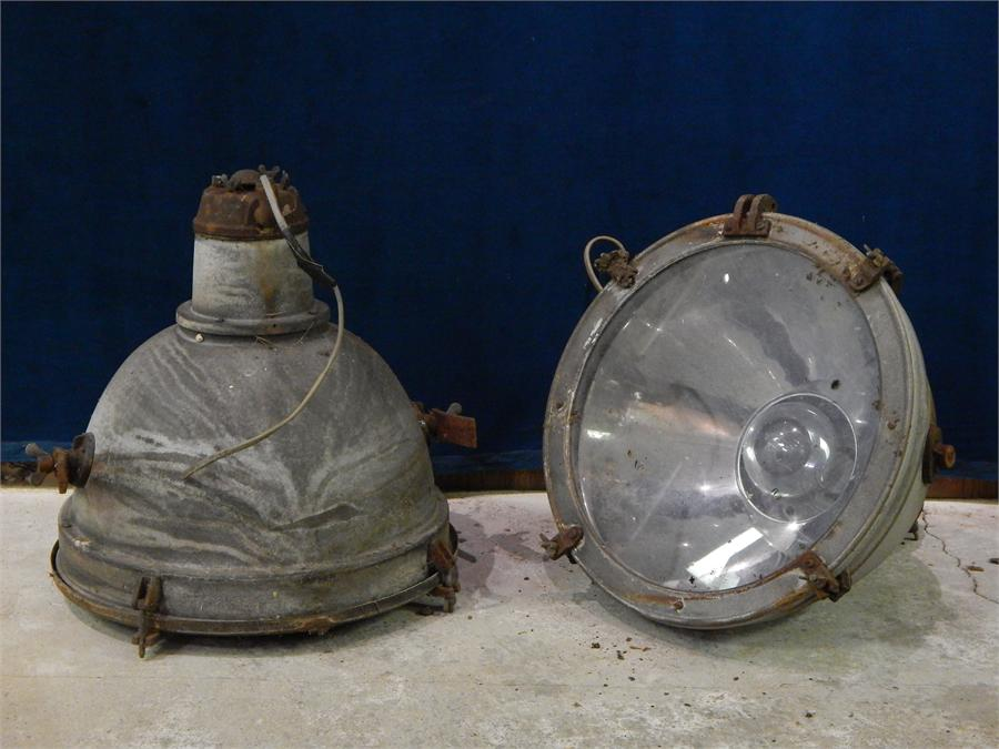 Lot 1 - A Pair of Galvanised Industrial Lamps with Glass Covers, could be hung on chains or floor mounted.