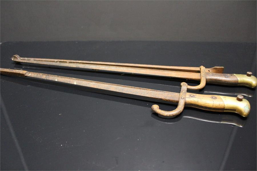 Lot 9 - Fire Irons with handle in the shape of a sword handle. Adapted from late 19th century sword