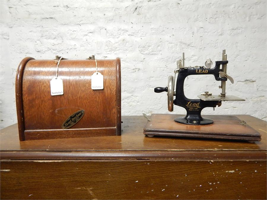 Lot 36 - Small hand sewing machine, made by Lead in Japan. Dimensions are 6.5'', 9.5'' by 8.25'' with
