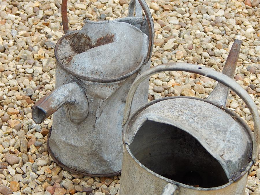 Lot 22 - two galvanised watering cans