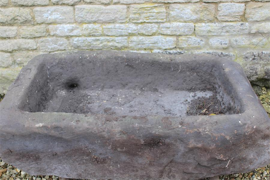 Lot 4 - A Large stone trough garden planter, previously from a farm in Yorkshire, measuring approximately: