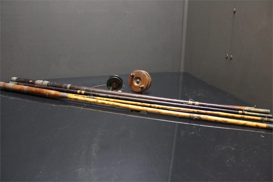 Lot 29 - Two Fly Fishing Rods, one of which is bamboo and Two Fly Fishing Reels- one wooden, one bakelite