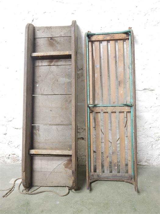 Lot 13 - Two sledges, one wooden and one in wood and metal.