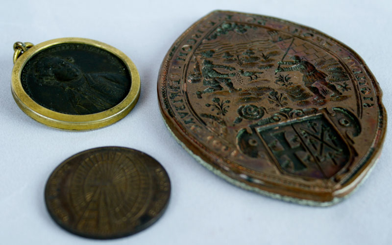 Lot 655 - Bronze and lead backed seal of Thomas Dove, Bishop of Peterborough 1601, of lozenge shape, 8 1/2