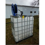 Poly oil tank w/ pump, hose, and reel
