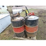 2 fuel barrels- w/ pump, hose, and reel