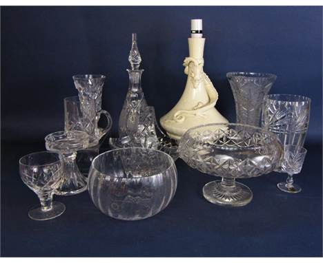 A collection of cut glass ware including a Waterford crystal vase, 17.5cm, a glass bowl on stand, decanter and stopper, etc,
