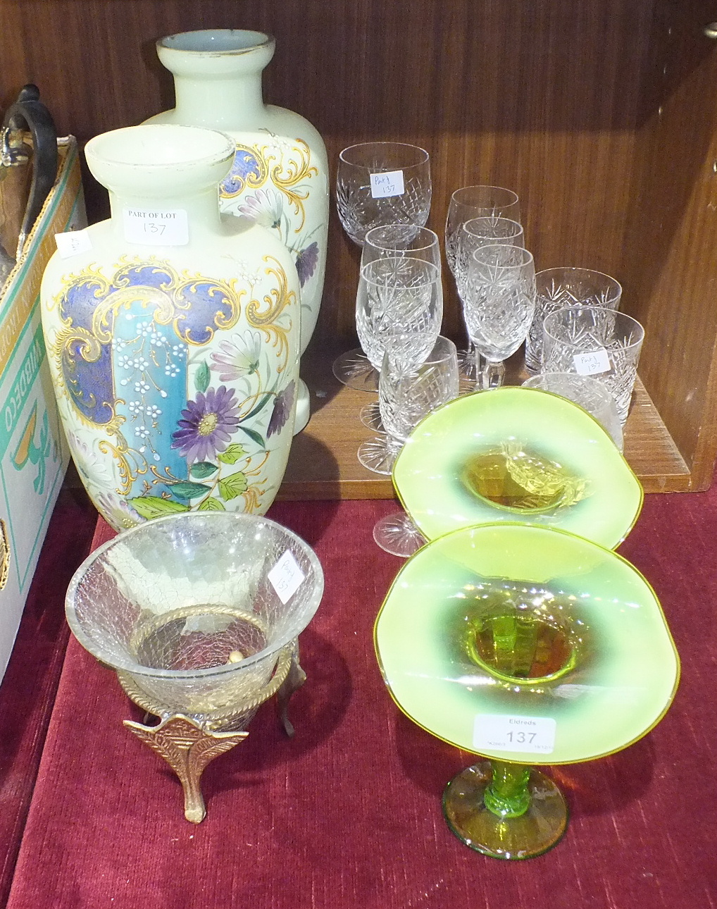 Lot 137 - A pair of Late-Victorian green glass baluster shape vases with coloured enamel floral decoration,