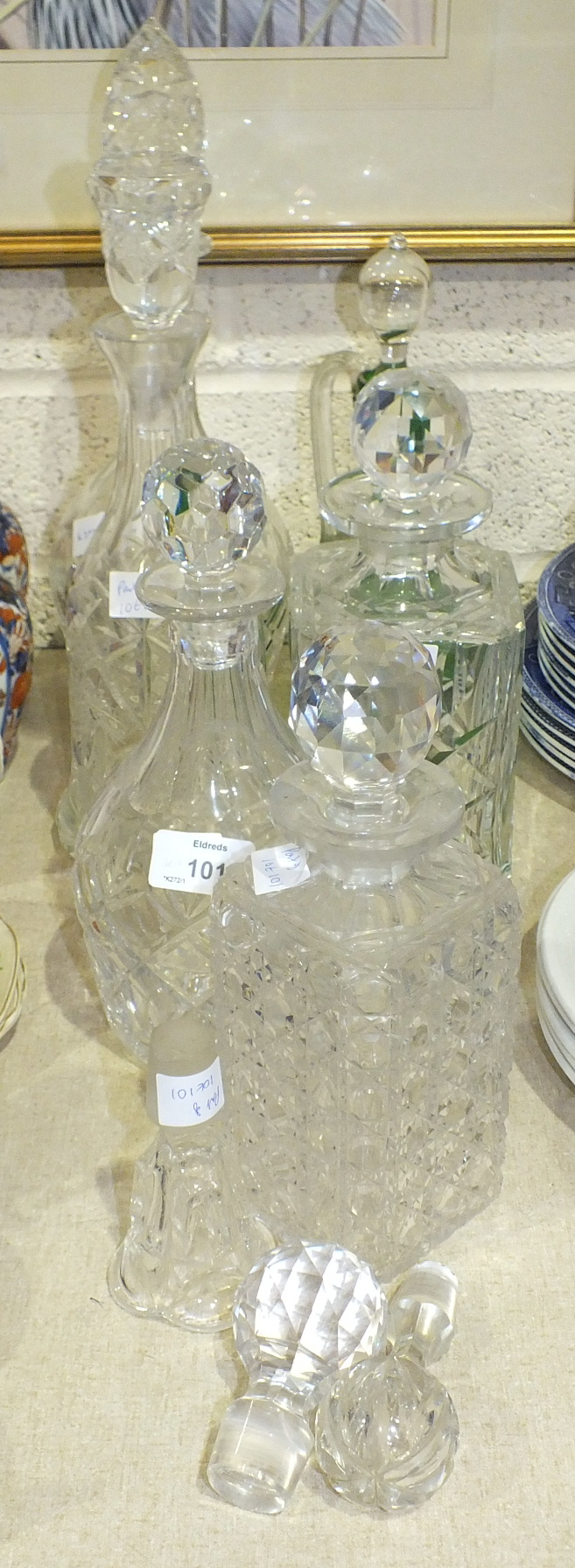 Lot 101 - A collection of six various glass decanters and stoppers, (6).