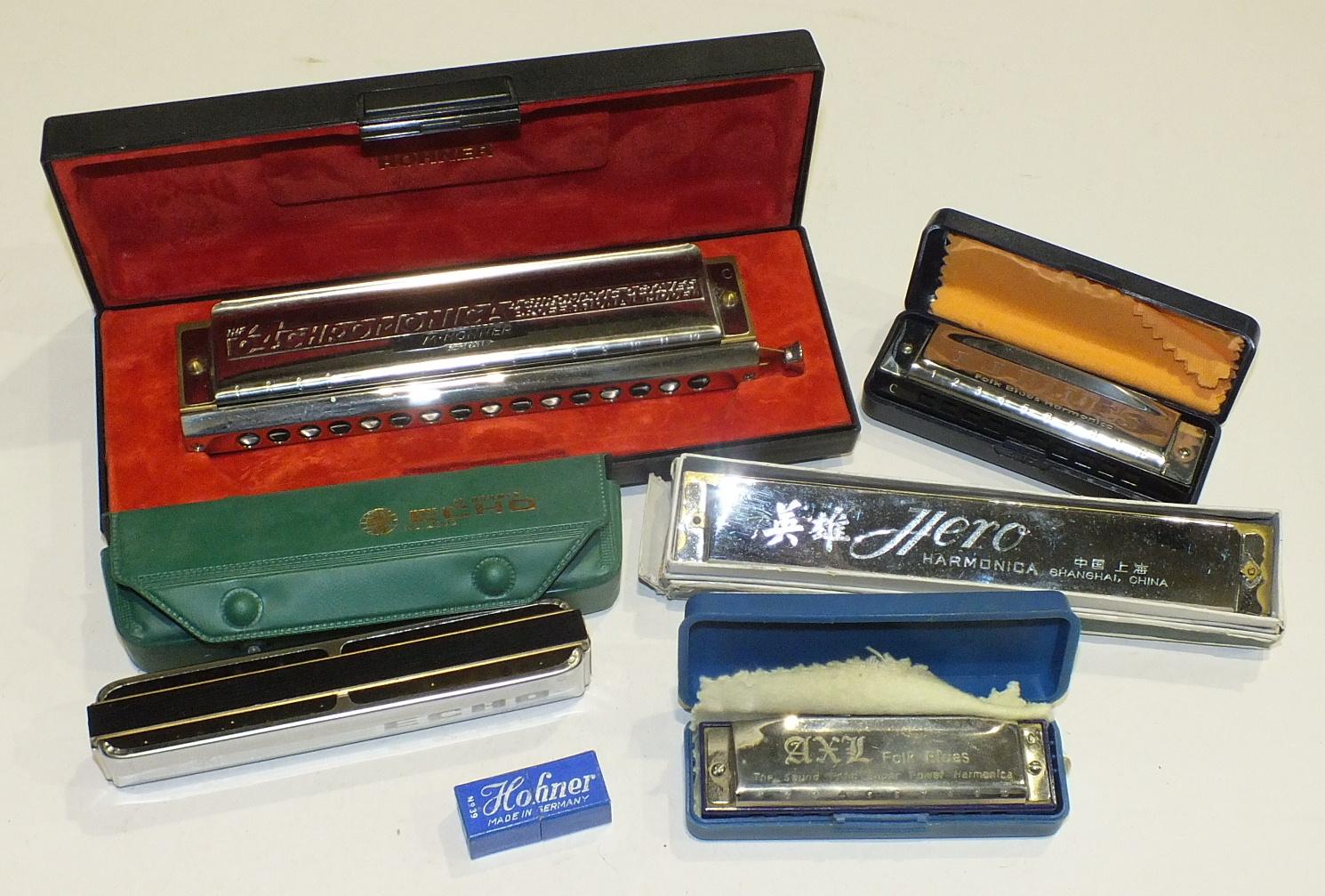 Lot 227 - A collection of six harmonicas, including a Hohner Chromonica 280C, a Hohner Echo no.2309, a