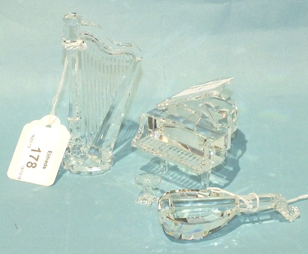 Lot 178 - A Swarovski crystal glass model of a grand piano, 7cm high, 6.5cm wide, with stool, a lute and a