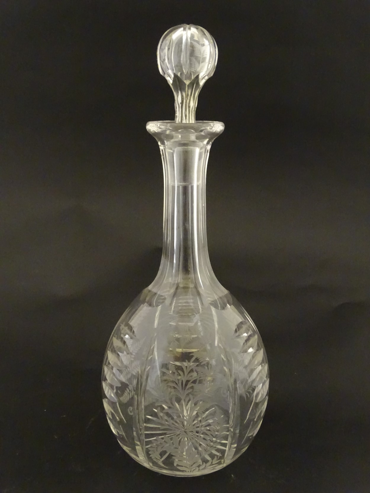 Lot 96 - Victorian Glass : a Victorian ' Fernware ' decorated decanter with stopper having a star cut